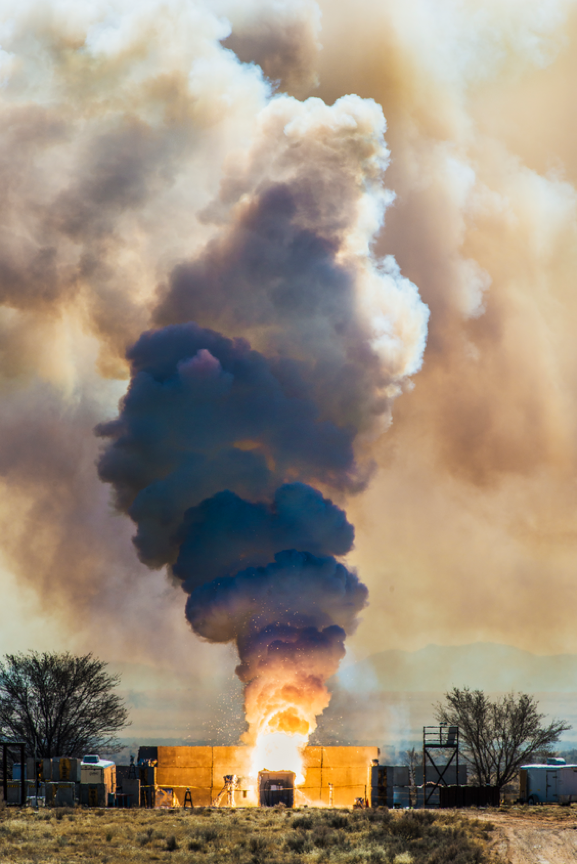 A full scale solid rocket motor burn with a breached case used for determining the thermal environment in an abnormal thermal event for weapon system.