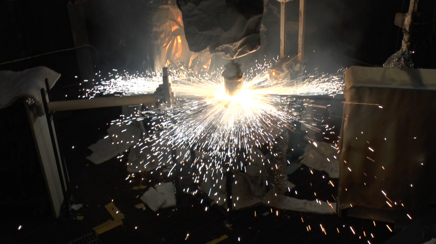 Burning block of solid rocket propellant on to substrates of interest (concrete, steel, insulation, etc.) used to characterize the thermal environment in a launch accident scenario.
