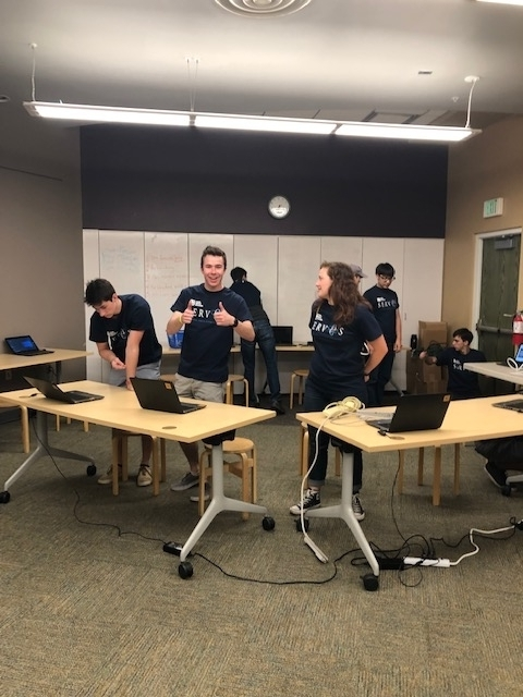 TITANS interns working at laptops.