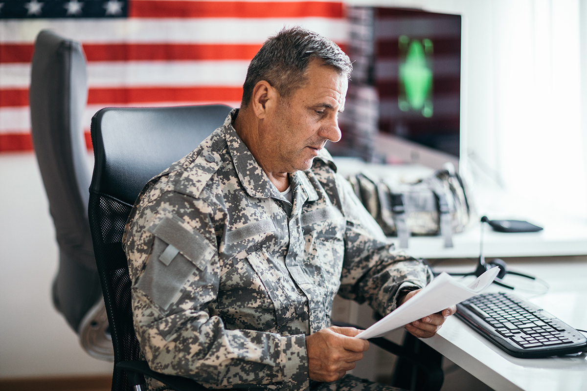 Military personnel reviewing paperwork