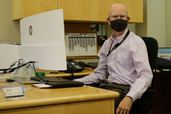 Andy McIlroy in his office