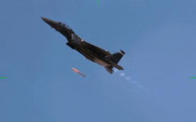 F15-E Strike Eagle fighter jet drops mock B61-12 bomb