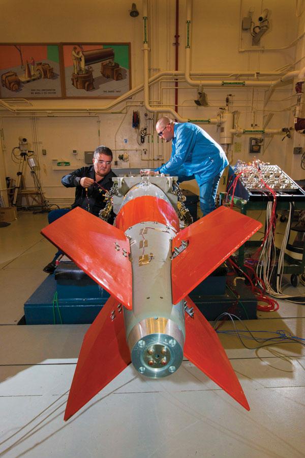 engineers place sensors on B61-12 test unit