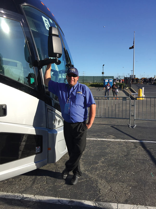 Brian Olson in front of bus
