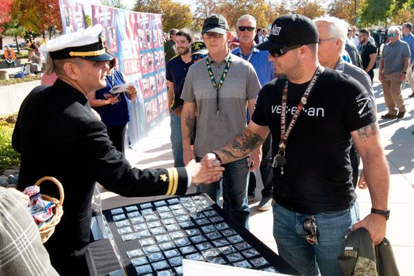 officer hands out veteran coins
