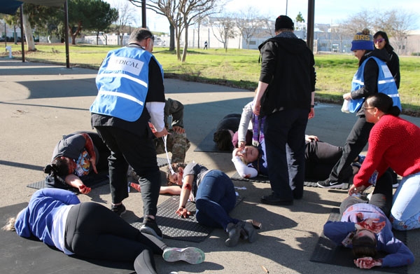 Medical personnel examine exercise victims