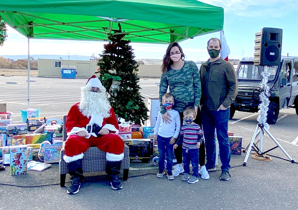 Kevin Manktelow and his family get their photo taken with a socially distanced Santa