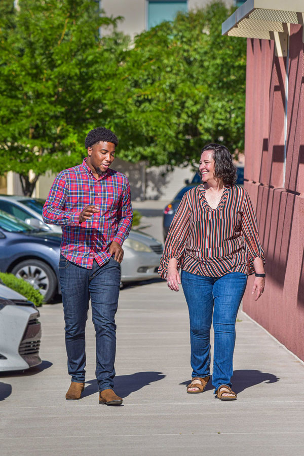 Logan Carpenter and Tommie Kuykendall walk on Sandia campus