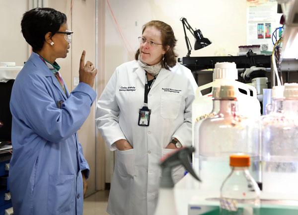 Cagle tours Cathy Branda's Sandia laboratory