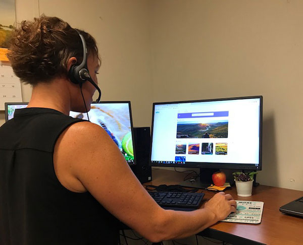 health educator conducts virtual wellness visit with employee