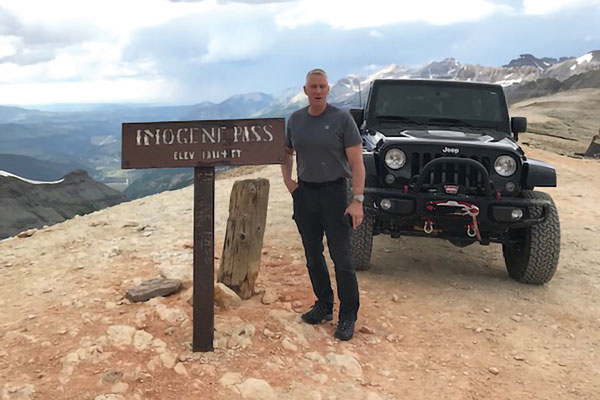 Harry Cincotta and his Jeep on mountain pass