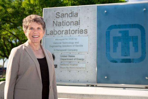 Dori in front of the Sandia sign at the Albuquerque campus