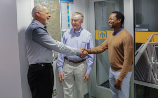 Sandia manager shakes hands with small business representatives