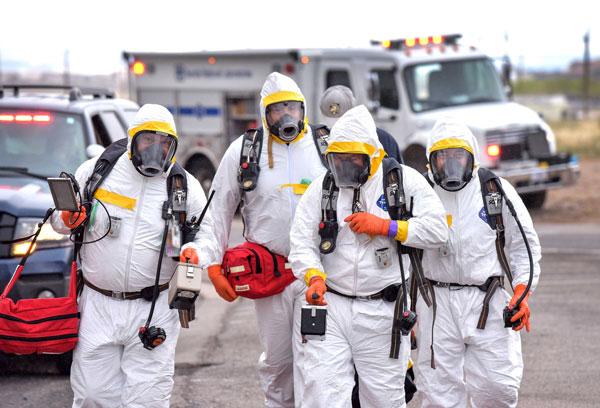 emergency responders dressed in hazardous material protection gear