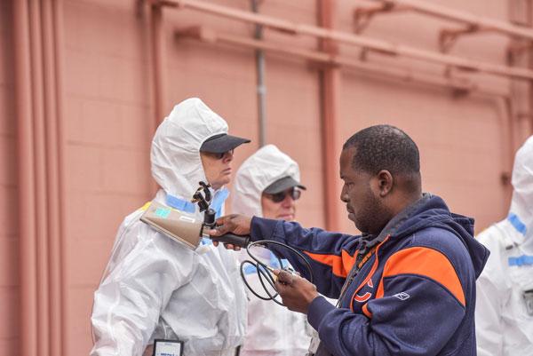technician scans emergency responder for radiation