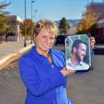 Theresa Rolfe holds a photo of her son Ted Benoit