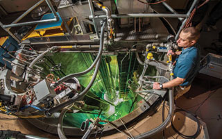 researcher looks over Annular Core Research Reactor