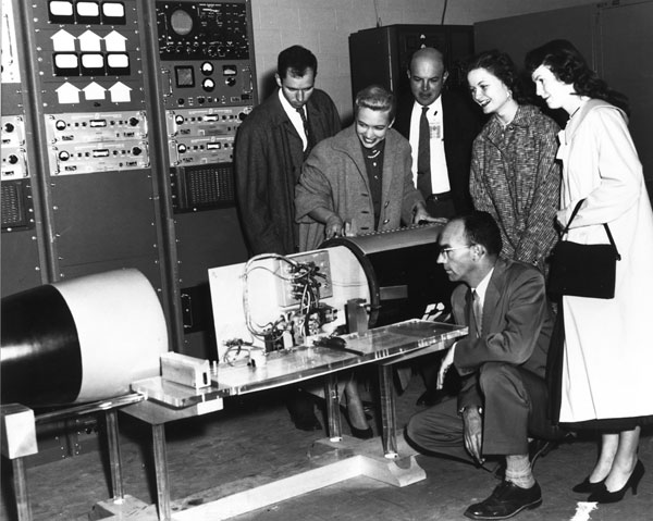 visitors inspect telemetry display at 1959 event