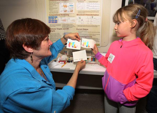 woman and child examine exhibit