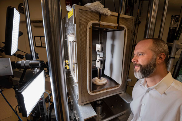 researcher works on ductile metals in lab