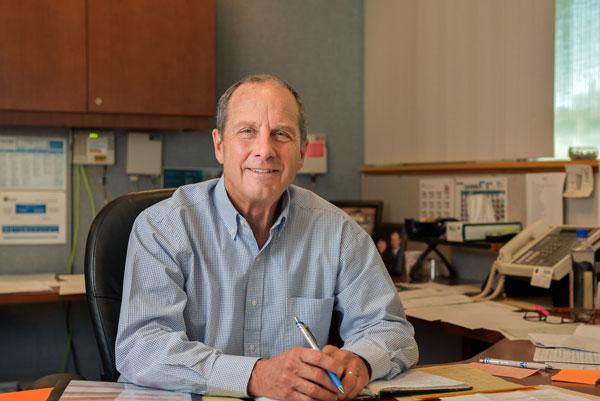 Steve Girrens sits behind his desk