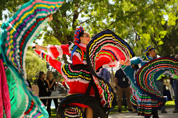 dancers in colorful costumes