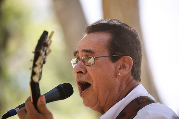 Roberto Griego playing guitar and singing