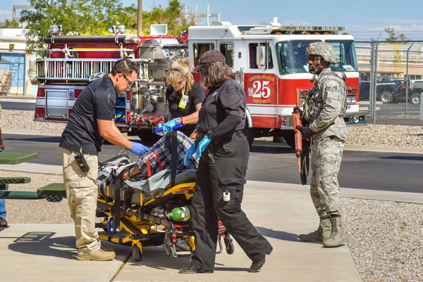 emergency responders assist an injured victim during an exercise