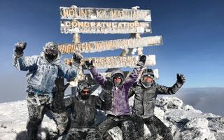 group photo at Kilimanjaro summit