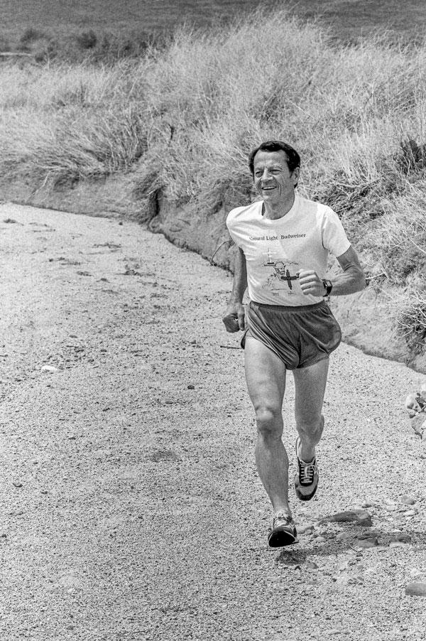 Larry running in desert