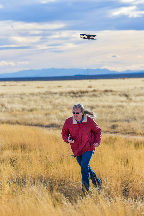 researcher with UAS in flight