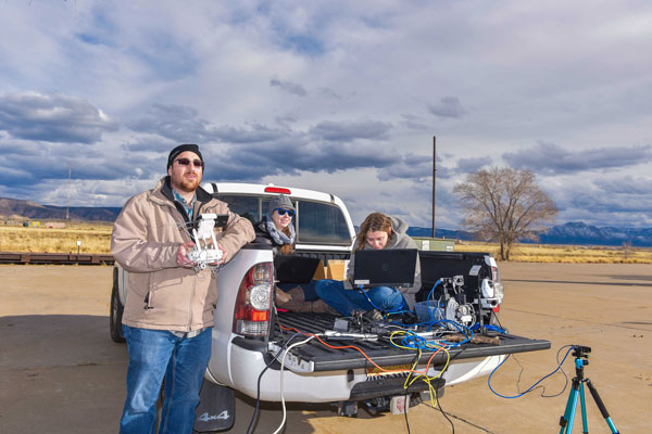 researchers on ground testing UAS components