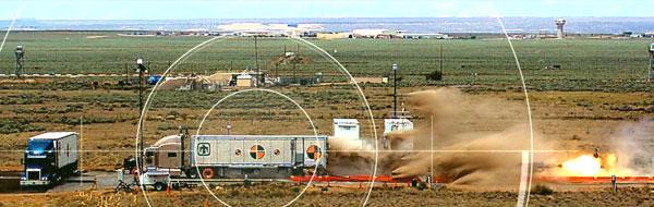 semi-trailer heads toward MGT prototype on rocket sled track