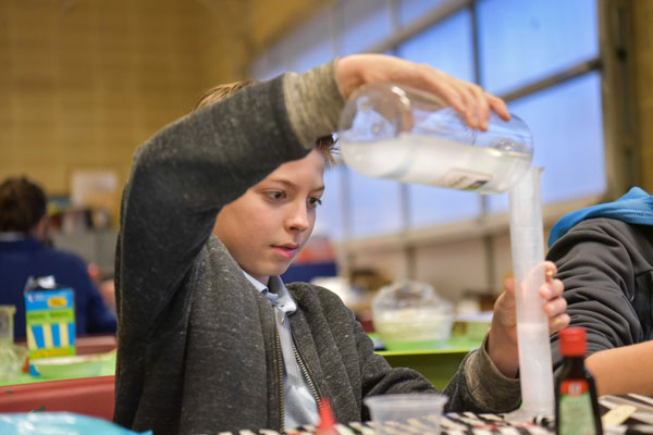 student works on chemistry experiment
