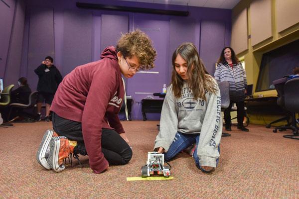 students test robot vehicle