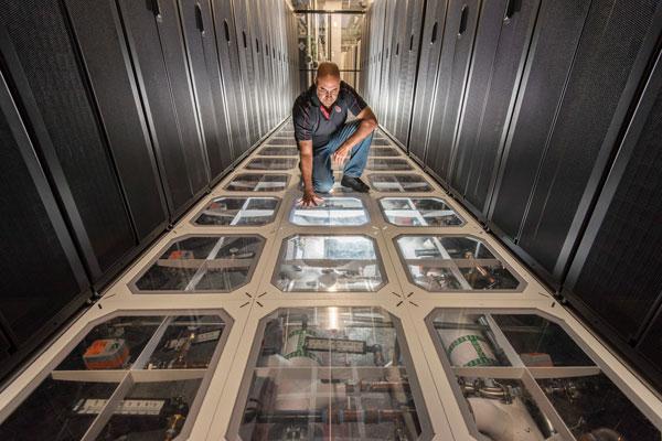 David J. Martinez examines the cooling system at Sandia's supercomputing center