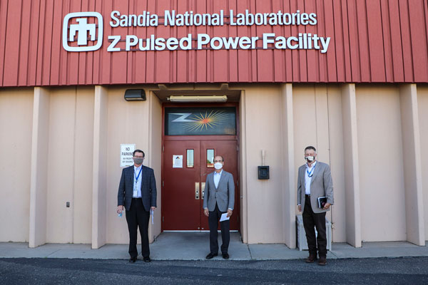 Mark Menezes, James Peery and Jeff Harrell in front of Z Pulsed Power building