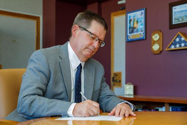 Peery signs assessment letter