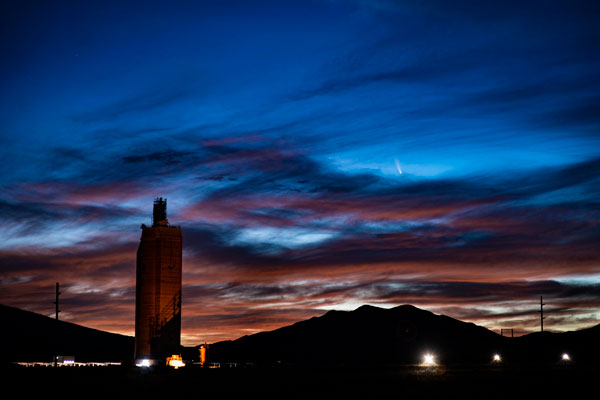 NEOWISE comet in night sky over Labs solar tower