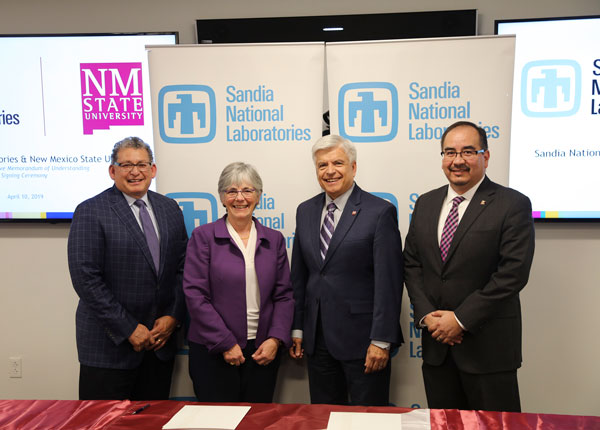 Sandia and NMSU execs at signing event