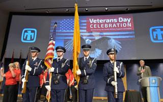 Honor guard presents flags