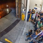 group gathers outside warehouse to view combustion experiment