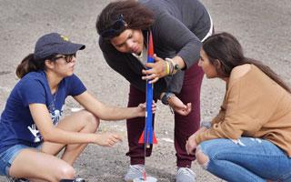 intern and students set up a rocket