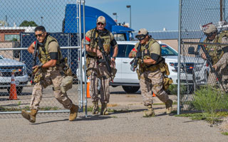 officers storm building during exercise