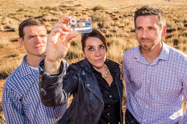 scientists hold up pocket-sized anthrax detector