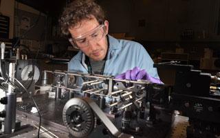 optical scientist works on microsopy equipment