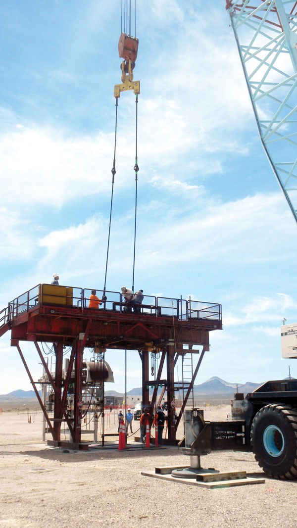 researchers work on drill rig to set up borehole test