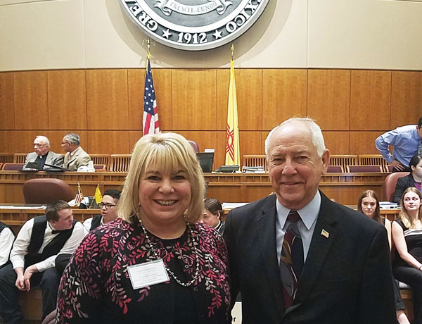 Jackie Kerby Moore poses with state Sen. Jim White