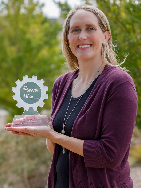 Christina Beppler holding her SWE award