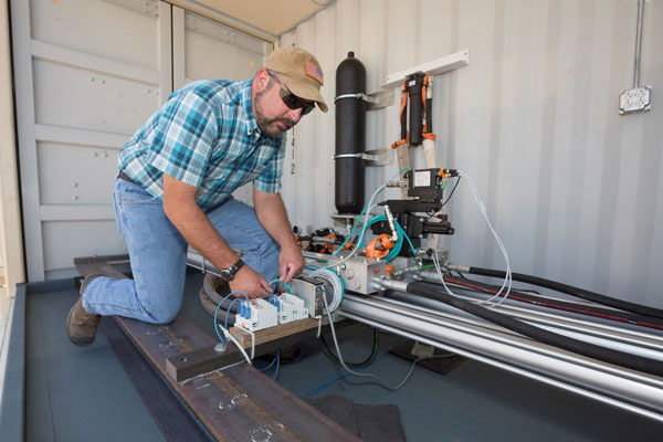 scientist works on SWEPT lab equipment